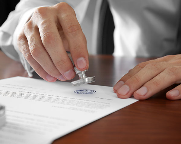 Notary signing a will and last testament